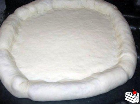 Красивое оформление краев пиццы.